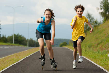 rollerblading: Active young people - rollerblading, running Stock Photo
