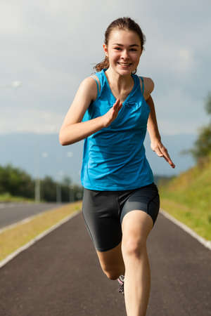 Girl running, jumping outdoor