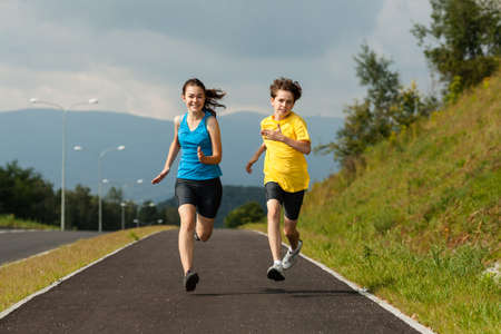 Girl and boy running, jumping outdoor