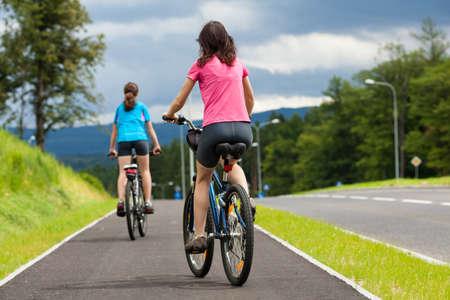 bicycle lane: Women riding bikes