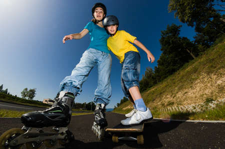 Active young people - rollerblading, running photo
