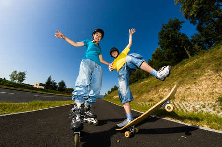 Active young people - rollerblading, skateboarding photo