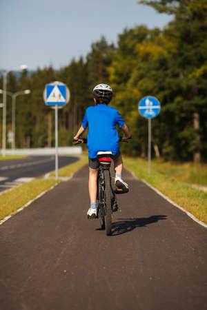 one lane: Boy biking