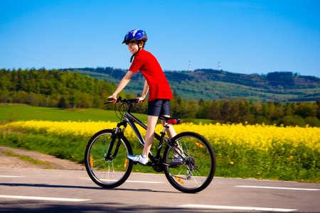 Boy biking photo