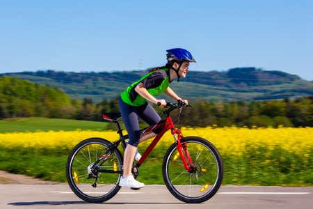 riding bike: Girl biking