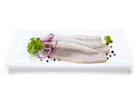 Marinated herring fillets with vegetables photo