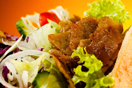 gyros: Kebab - grilled meat, bread and vegetables Stock Photo