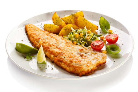 Fish dish - fried fish fillet with vegetables photo