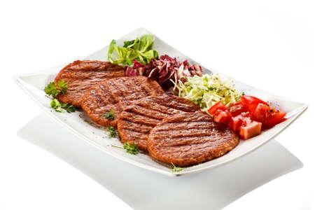 pork chops: Grilled steak and vegetables