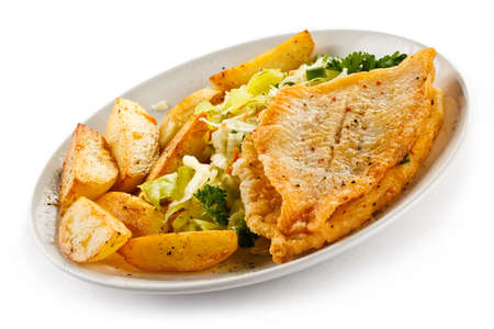 potato cod: Fish dish - fried fish fillets and vegetables