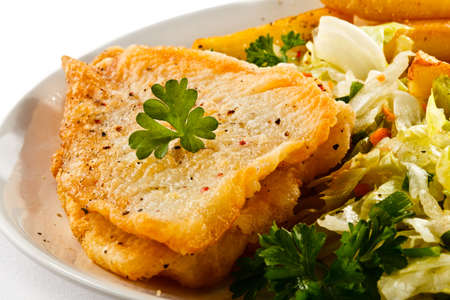 cod fish: Fish dish - fried fish fillets and vegetables