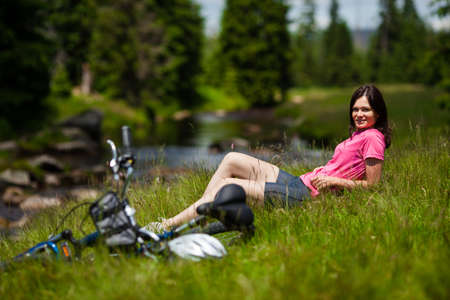 Woman resting after biking photo