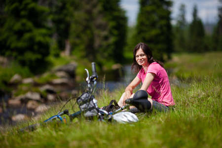 bike trail: Woman resting after biking