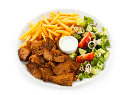 chicken grill: Grilled meat with French fries and vegetables