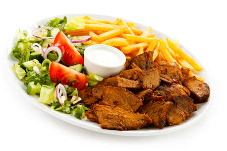 doner: Grilled meat with French fries and vegetables