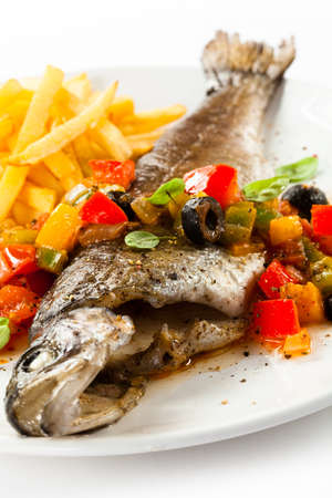 potato cod: Fish dish - roast trout and vegetables on white background