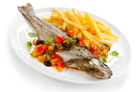Fish dish - roast trout and vegetables on white background photo