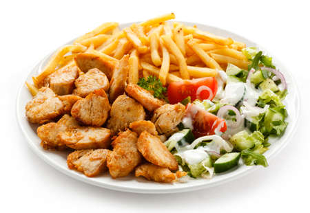 french fries plate: Grilled meat with French fries and vegetables