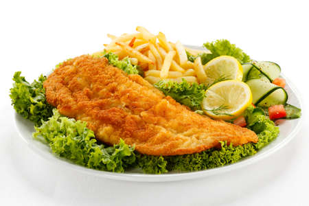 french fries plate:  Fish dish - fried fish fillet, French fries with vegetables