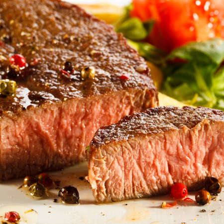 beef steak: Grilled steaks, French fries and vegetables