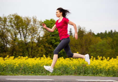 dynamic activity: Woman running, jumping outdoor