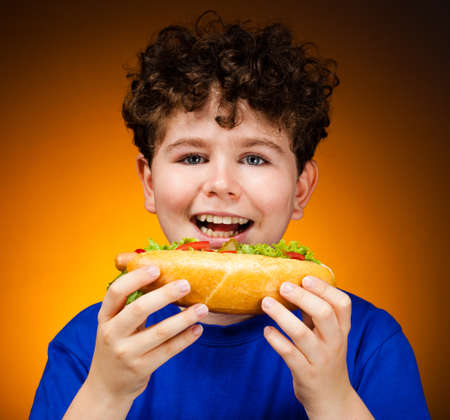 Boy eating big sandwiches photo