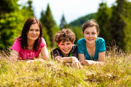 Happy family resting outdoor Stock Photo - 18659919