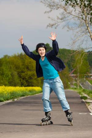 Girl rollerblading photo
