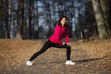 40 45: Woman exercising outdoor Stock Photo