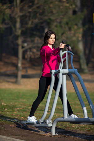age 40 45 years: Woman exercising outdoor Stock Photo