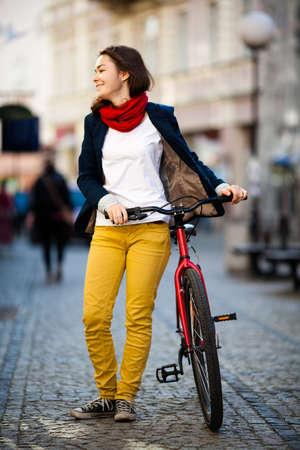 bicyclists: Urban biking - girl and bike in city