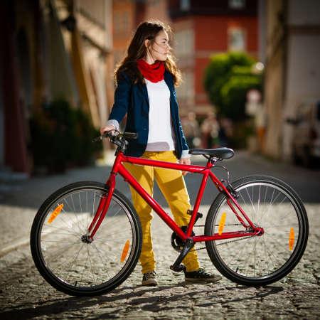 woman bike: Urban biking - girl and bike in city