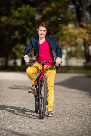 Girl biking photo