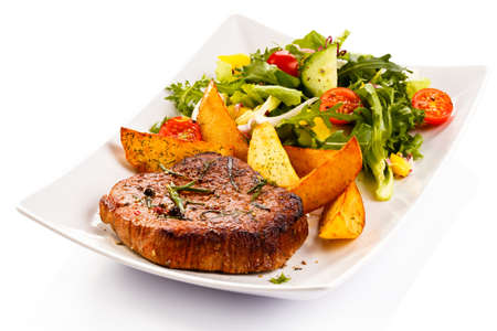 steak dinner: Grilled steak, baked potatoes and vegetables