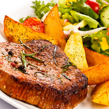 loin: Grilled steak, baked potatoes and vegetables
