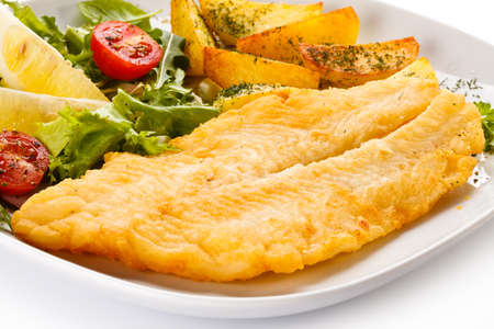 animal foot: Fish dish - fried fish fillet and vegetables Stock Photo