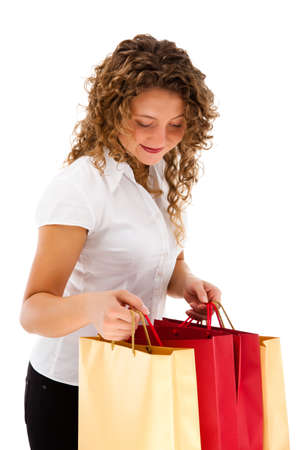 Young woman holding shopping bags isolated on white background Stock Photo - 18918755