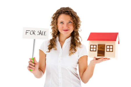 Woman holding model of house isolated on white background photo