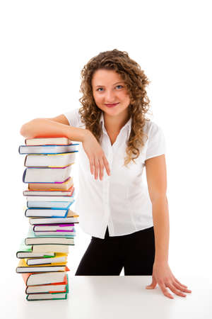 Young woman behind pile of books isolated on white background Stock Photo - 18918748