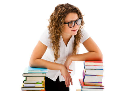 Young woman behind pile of books isolated on white background photo