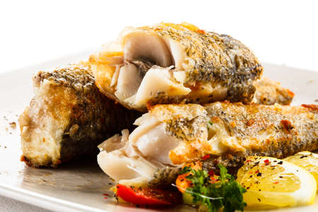 Fish dish - fried fish and vegetable salad photo