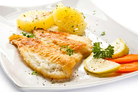 soles: Fish dish - fried fish fillet with vegetables