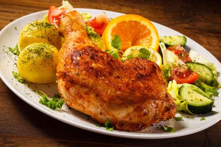 chicken leg: Grilled chicken leg with vegetables