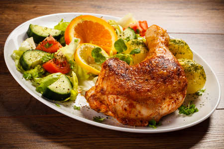 Grilled chicken leg with vegetables photo