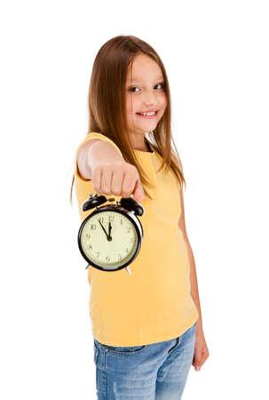 harry: Girl holding alarm-clock isolated on white background Stock Photo
