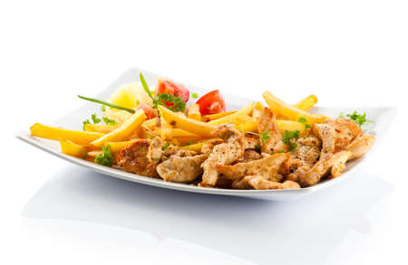 Grilled meat French fries and vegetables on white background