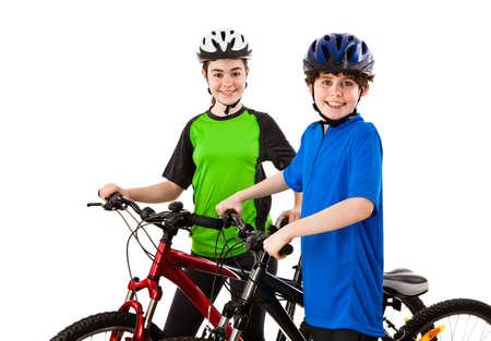 niños en bicicleta: Cyckists - ni?o y ni?a aislados en fondo blanco