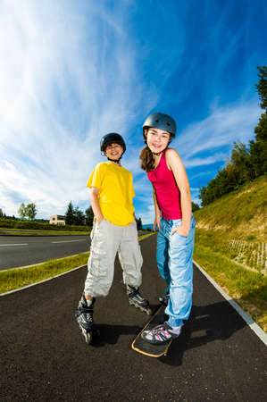 rollerblading: Active young people with roller skate and skateboard