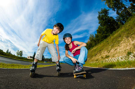 skateboarding tricks: Active young people with roller skate and skateboard