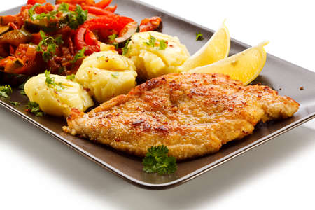 Pork chops, mashed potatoes and vegetable salad photo